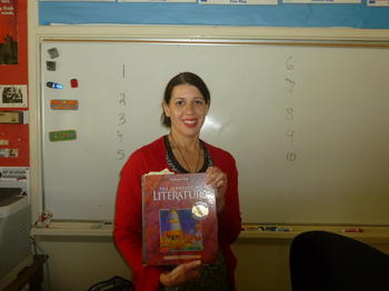 Ms. Ribeiro shows the textbook she uses to educate her students.